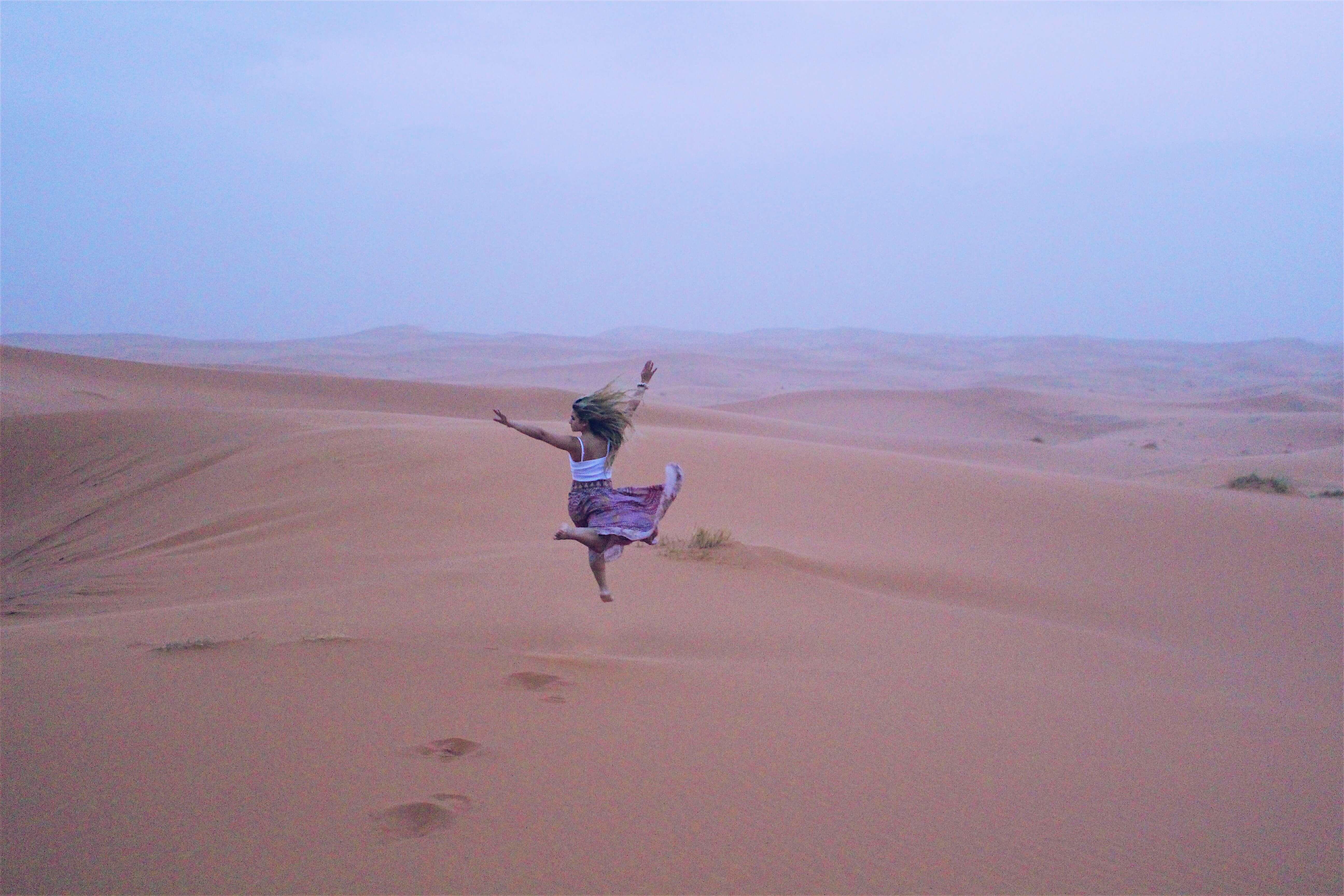 Sahara desert Morocco girl jumping